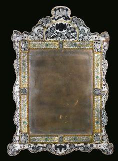 A German Baroque verre églomisé mirror Lohr, circa 1725-30 height 72 1/4 in.; width 51 1/4 in. 183.5 cm; 130.5 cm