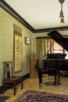 The tansu behind the piano was used to hold shoes in a Japanese entry. The Qing Dynasty-style chair may date from the 1950s; the scroll tells the origins story of sun goddess Ameterasu.