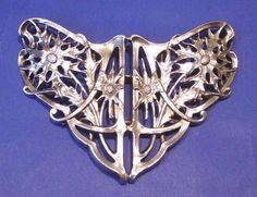 "An Art Nouveau silver nurse's buckle  Made by R. Martin and E. Hall in Chester, 1911 Length 3.75"" (9.5cm) Price £445.00"