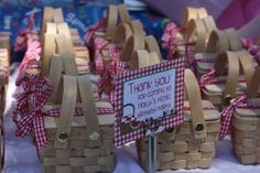 Wedding favors: mini picnic basket w/green gingham fabric, filled with a mini apple pie and jar of caramel sauce.