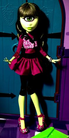 Iris Clops Monster High Doll  (I have her.) - She is the daughter of The Cyclops. She is 15. She loves star-gazing. She thinks she has a discerning eye for fashion & it's easy for her to focus in on the designs & styles that best suit her. Her pet peeve is not being able to find a pair of stylish, off-the-rack sunglasses. Her freaky flaw is that she's a little clumsy. She likes to blame it on her lack of depth perception, but she doesn't always watch where she's going. She is dating Manny…