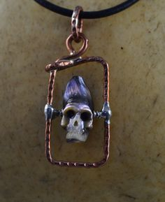 Purple Grey Pearl Carved into a Skull, Framed in Copper and on Leather Cord; Pearl Necklace