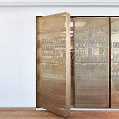 Revisiting this fantastic perforated brass storage system by Retail Architects a. Revisiting this fantastic perforated brass storage system by Retail Architects and Arstiderne Arkitekter. Photo by M Built In Furniture, Steel Furniture, Drinks Cabinet, Liquor Cabinet, Metal Screen, Perforated Metal, Wine Storage, Cabinet Design, Storage Cabinets
