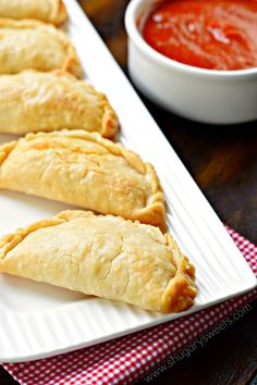 Pepperoni Pizza Hand Pies Flaky pie crust filled with pepperoni and cheese. These baked Pepperoni Pizza Hand Pies are ready in minutes and make a great meal! Pie Crust Recipes, Pizza Recipes, Appetizer Recipes, Cooking Recipes, Pizza Pie Crust Recipe, Skillet Recipes, Meat Appetizers, Cooking Gadgets, Savory Hand Pie Dough Recipe