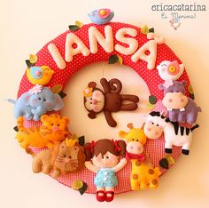 felt animals on a wreath - would be great on the door of a child's bedroom