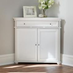 Create more room in your home with the help of this valuable Home Decorators Collection Hampton Harbor White Storage Cabinet. Entryway Storage Cabinet, White Storage Cabinets, Dining Room Storage, Bedroom Storage, Bath Storage, Corner Cabinet Living Room, White Corner Cabinet, Dining Room Corner, Corner Cabinets