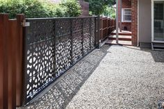 Rear view: Sliding automated entry gates, laser cut and powder coated by Entanglements metal art.