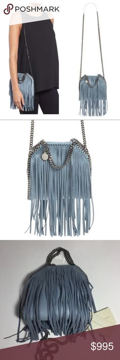 """STELLA MCCARTNEY TINY FRINGE FALABELLA Authentic NWOT Stella Mccartney Tiny Falabella Bag with fringe detail in """"ash blue"""". Light blue faux leather with some gray undertones. Gunmetal hardware.  Includes cards. No dustbag. Approx 6""""W x 5""""H x 2""""D. 2"""" top handle drop, 19"""" shoulder strap drop. Long, swingy fringe detail. Diamond cut chain strap and handles w/ logo disc charm. Interior slip pocket. Fabric lining. Made in Italy. ❌❌NO TRADES NO PP NO EXCEPTIONS❌❌ Stella McCartney Bags Shoulder…"""