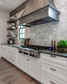 Cuisine Southern Living House in Little Rock Arkansas designed by the Sisters of Providence Design. White Kitchen Cabinets, Kitchen Redo, Kitchen Countertops, New Kitchen, Kitchen Remodel, Kitchen Design, Kitchen Backsplash, Backsplash Design, Black Countertops