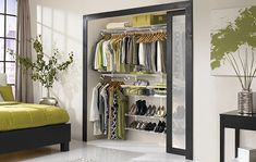 Beautiful closet by Rubbermaid. I love that you can move the shelves, hang rods and baskets to fit your needs!