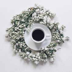 Coffee and white lilacs