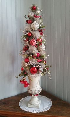 This tall tree is decorated with various berries, vintage garland, vintage glass ornaments, red mercury glass birds, velvet leaves and greens. Set in a vintage urn with vintage red bells dangling from one side. This one of a kind, rustic chic tree centerpiece stands 25 tall, 8 across and 7 deep. So much prettier in person! **About my vintage trees** I have ALWAYS been an ornament FANATIC! I really enjoy creating these trees and lovingly spend many hours assembling each of them, choosing t...