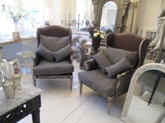 Gorgeous pair or grey wing back chairs.