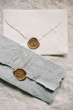 Gold wax seal on handmade paper.