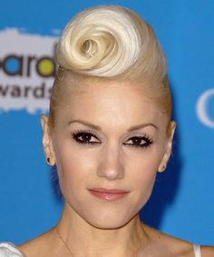 An older Gwen Stefani on the red carpet rocks a curled wave up-do. All the elegance of the red carpet with all of Gwen's personality #gwenstefani #hair