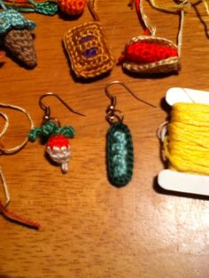 Crochet food earrings using a 1.5 mm hook and DMC floss. Radish pattern By Genuinemudpie on Ravelry.com