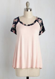 Whether you're partaking in pickup kickball or lounging on a blanket, this raglan tee hooks you up with a lively look. Pale pink in hue, with navy blue, floral shoulders and a high-low hem, this soft top turns on the casual charm!