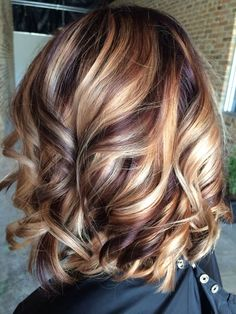 Brunette hair with blonde and red highlights.