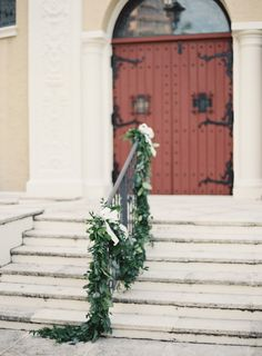 sweet and simple garland decorating the entrance at the church ceremony