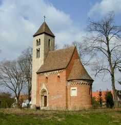 Csempeszkopács - Hungary  - Photo by Gabó.  The aisleless church with frontal tower of this small village in Vas County was erected in the middle 13th century.
