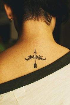 arrow tattoo. I kind of like the placement, but maybe a little bit lower