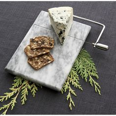 Slice and serve cheese in style with cheese boards, knives and tools from Crate and Barrel. Browse serving pieces, cheese slicers and more. Order online.
