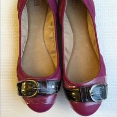 Fuchsia flats w/ black buckle detail.Felisha. NIB Fuchsia to the purplish in color. Black buckle detailing across the toe. Elastic for comfort fit. Cushiony insoles. Plastic protective wrap is still on buckles to avoid scratches. This maker runs on the small side. I am usually between a 6.5 and 7 but these 7s are a perfect fit for me. I have 2 other pairs of these and I love them. Michael Antonio Shoes Flats & Loafers