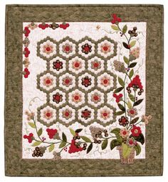 Traditional Grandmother's flower garden combined with appliqued pieces make a unique and beautiful quilt.