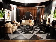 Parisian Art Deco by Danielle Colding as seen on HGTV's Design Star ...LUV the shiny velvet couch and chairs, the Oscar-ish light statues, and the panther!!!