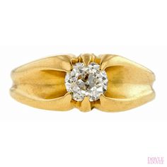 Antique diamond engagement ring, an Old Mine cut diamond in a stylized belcher setting, in 14k yellow gold. Circa 1900, from Doyle & Doyle.