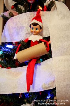 elf rolls the tree ... love the idea of creating mischievous situations like these (even if it means cleaning them up the next day)