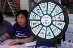 SeniorsWheel at Chinatown Festival | Buy this Prize Wheel at http://PrizeWheel.com/products/tabletop-prize-wheels/.