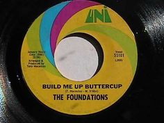 Build Me Up Buttercup  My brothers, sister and I would put our record player in the window and blast this song for all the neighbor kids to hear!  Still one of my favorites!!!!  We had the 45 just like this one!