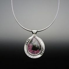 'Soul' Eudialyte and Sterling Silver Pendant Eudialyte is a stone of the heart, bringing harmony of heart matters, and dispelling jealousy. Emotionally it is helpful for learning to trust oneself and others, and eases compulsive behavior and thinking. It is said to help repair emotional damage and is about kindness to self and following your heart in a positive way.
