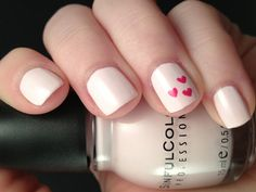 Baby pink nails with hearts by Consulting Nail Artist