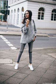 d7fcfa5ec98 Beatrice Gutu wears grey skinny jeans with a rolled up sweater and white  sneakers. Sweater