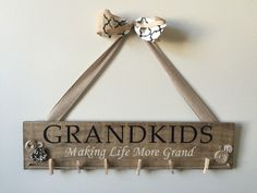 6x24 inch Grandkids sign with pins for pictures.  Colors stay the same, but ribbon and button patterns make vary. Order is processed and mailed with