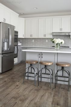 My friends gorgeous gray and white kitchen - vinyl plank flooring and wood and metal counter stools in grey and white kitchen - Kitchen Vinyl, Wood Floor Kitchen, Big Kitchen, Floors Kitchen, Kitchen With Grey Floor, Kitchen Ideas, Island Kitchen, Kitchen Decor, Kitchen Layout