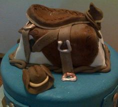 saddle and cowboy hat cake topper made by lerrin@sweetart