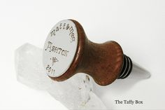 Perfect for the wine lover on your gift list! Personalized hand stamped wine stopper  http://thetaffybox.com/Personalized-Walnut-Wine-Bottle-Stopper-010.htm