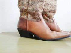 Wstern inspired tapestry boots by J. Jill. Leather upper with a tapestry shaft and dual side pull tabs. Short chunky heel for comfortable