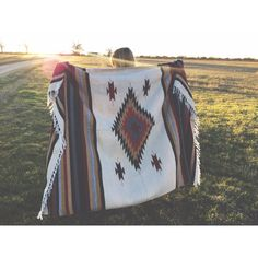 Rich earth tones and classic southwestern patterns easily make these thick, handwoven blankets a favorite! Measure 5 x 7 Made of 70% Acrylic and 30% polyester with a soft saddle blanket like feel