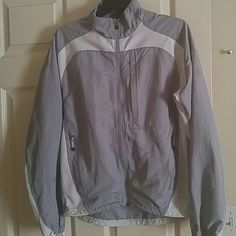 The North Face Windbreaker The North Face Windbreaker, men's small, it is a light gray color, no rips, zippers work fine, minimal wear present (if any) smoke free home. The North Face Jackets & Coats Utility Jackets