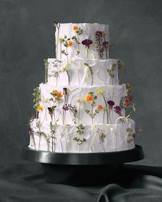 Contributing editorJason Schreibermade this herb-adorned cake, which featurespea shoots, fennel and cilantro blossoms, bachelor's buttons, sweet alyssums, oregano, and micro marigolds. Swiss meringue buttercream's tacky texture kept the edible flowers (buy your own at gourmetsweetbotanicals.com) in place.