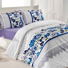 California Dreaming 6-Piece Duvet Set Rendered in ultra soft premium cotton, this sweet duvet set features a grey and white polka-dot design and a modern floral pattern in hues of blue, purple and green. The perfect addition to make your home sweet.