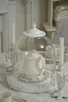 This cloche is made from an old light fixture...brilliant and beautiful!