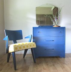 Refinished art deco dresser and mid-century modern Russell Spanner chair for Nova Scotia cottage