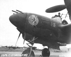 """P-38J Lightning """"Bambi"""" of the 338th Fighter Squadron assigned to Capt John L Odegard, probably at Ridgewell Airfield, Essex, England, May 16 1944. Behind P-38's nose wheel is B-17G Fortress """"Chug a Lug IV"""" with the 535th Bomb Squadron. 