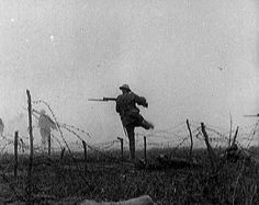 """A soldier runs through stretch of land between two opposing armies known as """"no man's land."""" No man's land was typically riddled with barbed wire and corpses. Source: """"Time To Remember - Enough Of Everything,"""" 1917 (film) Ww1 History, Military History, World History, World War One, First World, Foto Portrait, Flanders Field, No Mans Land, War Photography"""