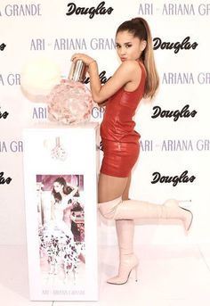 Red leather minidress and pink OTK boots Ariana Grande